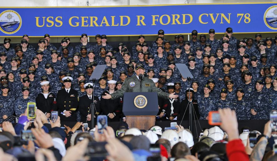 FILE - In this March 2, 2017 file photo, President Donald Trump gestures as he speaks to Navy and shipyard personnel aboard nuclear aircraft carrier Gerald R. Ford at Newport News Shipbuilding in Newport News, Va. (AP Photo/Steve Helber, File)