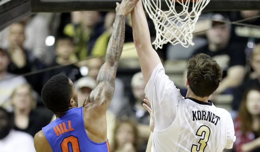 Florida guard Kasey Hill (0) fouls Vanderbilt forward Luke Kornet (3) in the first half of an NCAA college basketball game, Saturday, March 4, 2017, in Nashville, Tenn. (AP Photo/Mark Humphrey)