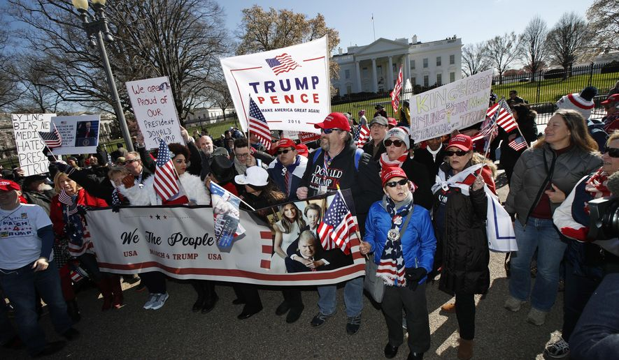 Supporters of President Donald Trump, march from the National Mall to the White House during a rally organized by the North Carolina-based group Gays for Trump, Saturday, March 4, 2017. The speakers at the rally talked about immigration, gay rights, and several other issues. (AP Photo/Manuel Balce Ceneta) ** FILE **