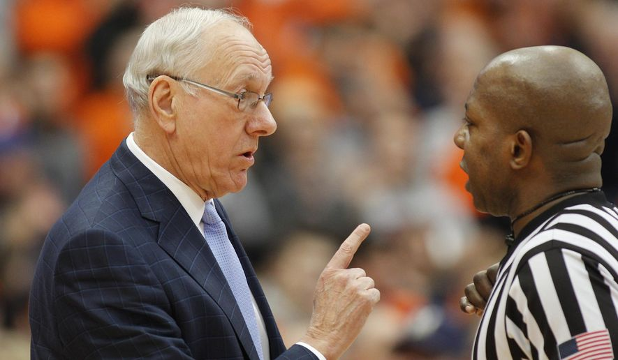 Syracuse head coach Jim Boeheim, left, talks with official Clarence Armstrong, right, in the first half of an NCAA college basketball game against Georgia Tech in Syracuse, N.Y., Saturday, March 4, 2017. (AP Photo/Nick Lisi)