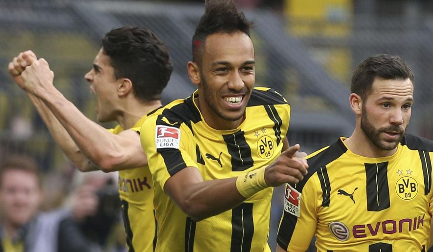 Dortmund's  Pierre-Emerick Aubameyang , center, celebrates a goal during the German Bundesliga soccer match between Borussia Dortmund and Bayer Leverkusen, in Dortmund, Germany, Saturday, March 4, 2017.  (Friso Gentsch/dpa via AP)