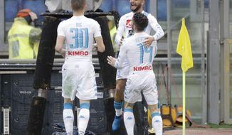 Napoli's Dries Mertens, right, back to camera, celebrates with his teammate Lorenzo Insigne and Marko Rog, left, after scoring during a Serie A soccer match between Roma and Napoli, at the Rome Olympic stadium, Saturday, March 4, 2017. (AP Photo/Gregorio Borgia)