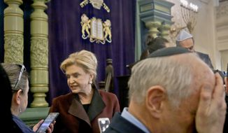 Congresswoman Carolyn Maloney, center, member of Congress's bipartisan task force combating anti-Semitism, speaks with a reporter after holding a press conference to address bomb treats against Jewish organizations and vandalism at Jewish cemeteries, Friday March 3, 2017, at the Park East Synagogue in New York. (AP Photo/Bebeto Matthews)