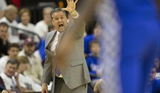 Kentucky head coach John Calipari yells to his team during the first half of an NCAA college basketball game against Texas A&M, Saturday, March 4, 2017, in College Station, Texas. (AP Photo/Sam Craft)