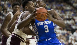 Kentucky forward Edrice Adebayo (3) drives the lane against Texas A&M forward Tavario Miller (42) during the first half of an NCAA college basketball game, Saturday, March 4, 2017, in College Station, Texas. (AP Photo/Sam Craft)
