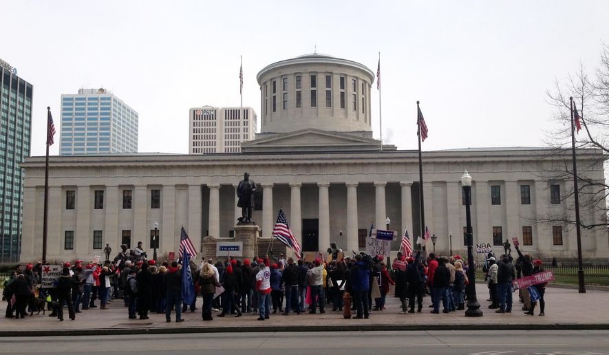 Supporters and opponents of president Donald Trump face off in front of the Ohio state house in Columbus, Ohio on Saturday, March 4, 2017.  The extraordinary clash of several hundred people in one of America's most closely-divided battleground states featured chanting and name-calling as well as opposing activists leaning in to try to hear each other out on the unconventional president. (AP photo/Julie Carr Smyth)