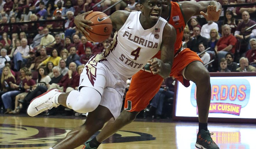Florida State's Dwayne Bacon drives to the basket as Miami's Davon Reed defends in the first half of an NCAA college basketball game, Saturday, March 4, 2017, in Tallahassee, Fla. (AP Photo/Steve Cannon)