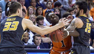Missouri guards Cullen VanLeer (33) and Jordan Geist (15) take the ball away from Auburn guard Jared Harper (1), Saturday, March 4, 2017, during an NCAA college basketball game in Auburn, Ala. (Julie Bennett/AL.com via AP)