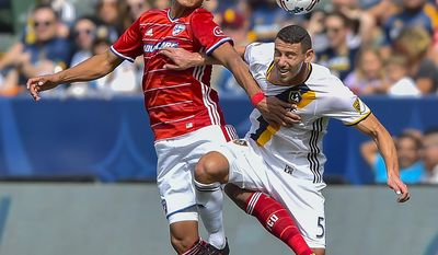 FC Dallas forward Cristian Colman, left, of Paraguay, and Los Angeles Galaxy defender Daniel Steres (5) fight for a header during an MLS soccer match, Saturday, March 4, 2017, in Carson, Calif. (AP Photo/Gus Ruelas)