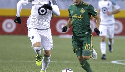 Portland Timbers' Sebastian Blanco (10) works with the ball against Minnesota United's Justin Davis (2) in an MLS soccer match Friday, March 3, 2017, in Portland, Ore. (Sean Meagher/The Oregonian via AP)
