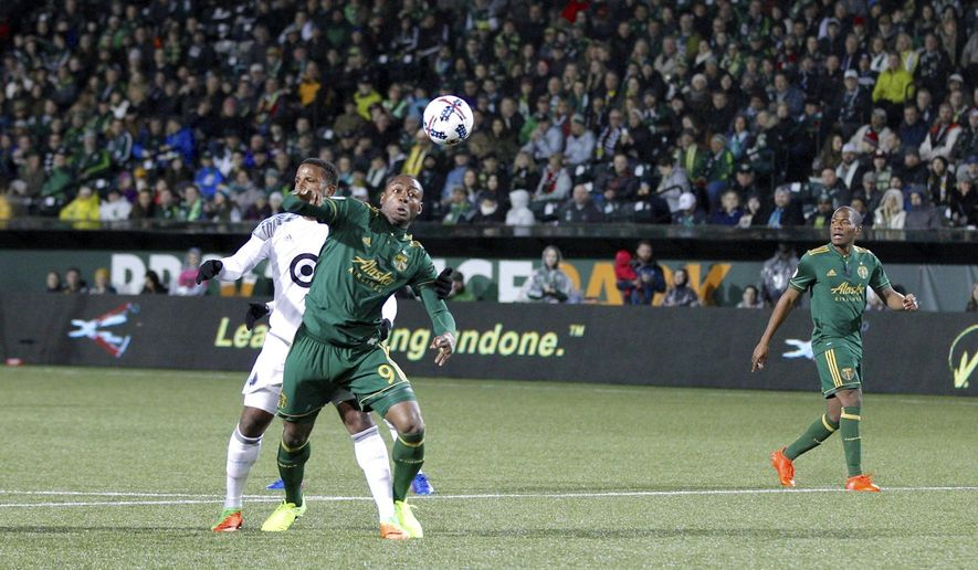 Portland Timbers' Fanendo Adi (9) tries to corral the ball, against Minnesota United in an MLS soccer game Friday, March 3, 2017, in Portland, Ore. (Sean Meagher/The Oregonian via AP)