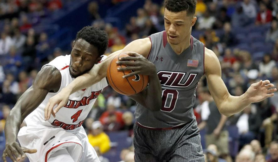 "Illinois State's Daouda ""David"" Ndiaye (4) and Southern Illinois' Jonathan Wiley fight for control of the ball during the first half of an NCAA college basketball game in the semifinals of the Missouri Valley Conference men's tournament, Saturday, March 4, 2017, in St. Louis. (AP Photo/Jeff Roberson)"