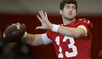 Nebraska quarterback Tanner Lee (13) throws on the first day of spring NCAA college football practice in Lincoln, Neb., Saturday, March 4, 2017. (AP Photo/Nati Harnik)