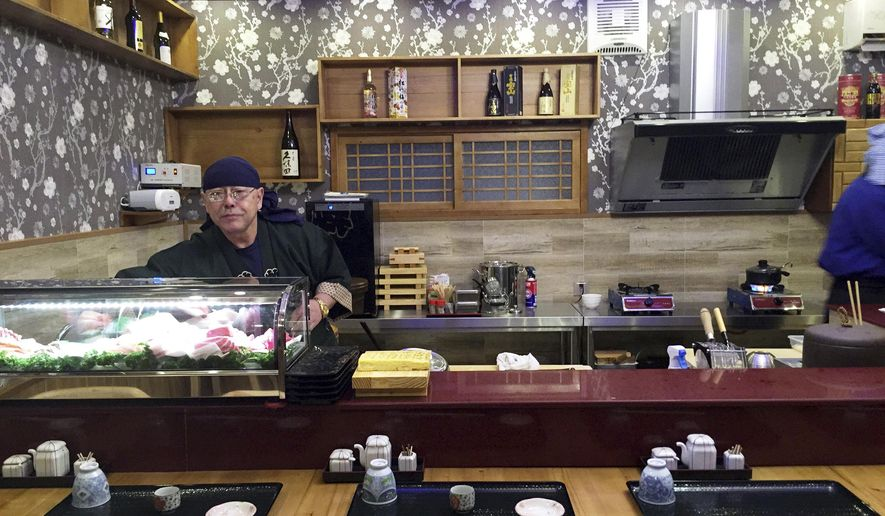 In this Feb. 19, 2017, photo provided by Paektu Cultural Exchange, Japanese sushi chef Kenji Fujimoto works behind the counter of his new restaurant in Pyongyang, North Korea. Fujimoto, a Japanese chef famous for working for North Korea's late leader Kim Jong Il, has returned to Pyongyang and opened the sushi restaurant. (Paektu Cultural Exchange via AP)