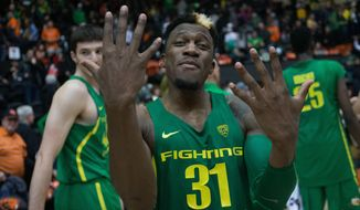 Oregon's Dylan Ennis (31) celebrates after Oregon defeated Oregon State 80-59 in an NCAA college basketball game Saturday, March 4, 2017, in Corvallis, Ore. (AP Photo/Timothy J. Gonzalez)