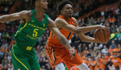 Oregon's Tyler Dorsey (5) tries to get the ball from Oregon State's Stephen Thompson Jr. (1) during the first half of an NCAA college basketball game Saturday, March 4, 2017, in Corvallis, Ore. (AP Photo/Timothy J. Gonzalez)