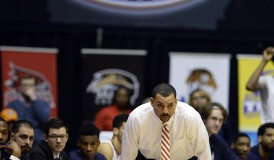 UT Martin head coach Anthony Stewart watches his players during the first half of an NCAA college basketball game against Jacksonville State in the championship of the Ohio Valley Conference basketball tournament Saturday, March 4, 2017, in Nashville, Tenn. (AP Photo/Mark Zaleski)