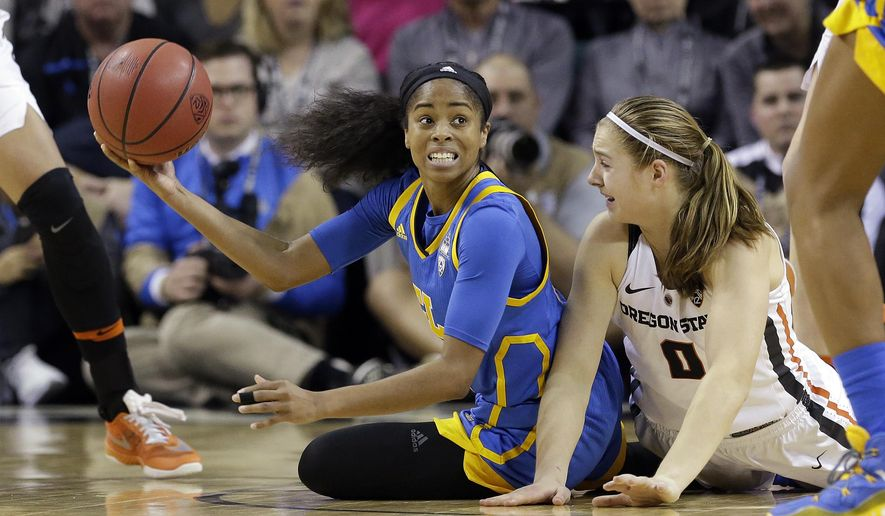 UCLA's Jordin Canada, left, looks for room to pass as Oregon State's Mikayla Pivec defends during the second half of an NCAA college basketball game in the Pac-12 tournament, Saturday, March 4, 2017, in Seattle. Oregon State won 63-53. (AP Photo/Elaine Thompson)