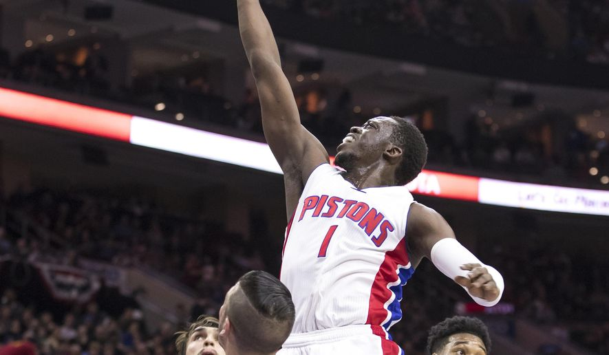 Detroit Pistons' Reggie Jackson, center, goes up for the shot against Philadelphia 76ers' TJ McConnell, left, and Richaun Holmes, right, during the first half of an NBA basketball game, Saturday, March 4, 2017, in Philadelphia. (AP Photo/Chris Szagola)