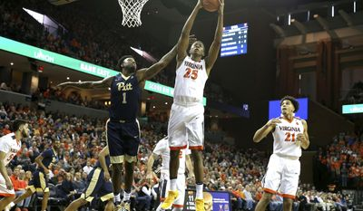 Virginia forward Mamadi Diakite (25) rebounds over Pittsburgh guard Jamel Artis (1) during the first half of an NCAA college basketball game Saturday, March 4, 2017, in Charlottesville, Va. (AP Photo/Ryan M. Kelly)