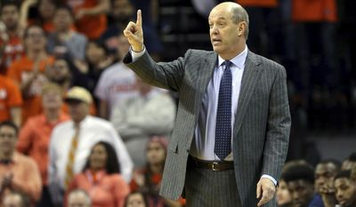 Pittsburgh head coach Kevin Stallings calls a play during the first half of an NCAA college basketball game against Virginia. Saturday, March 4, 2017, in Charlottesville, Va. (AP Photo/Ryan M. Kelly)