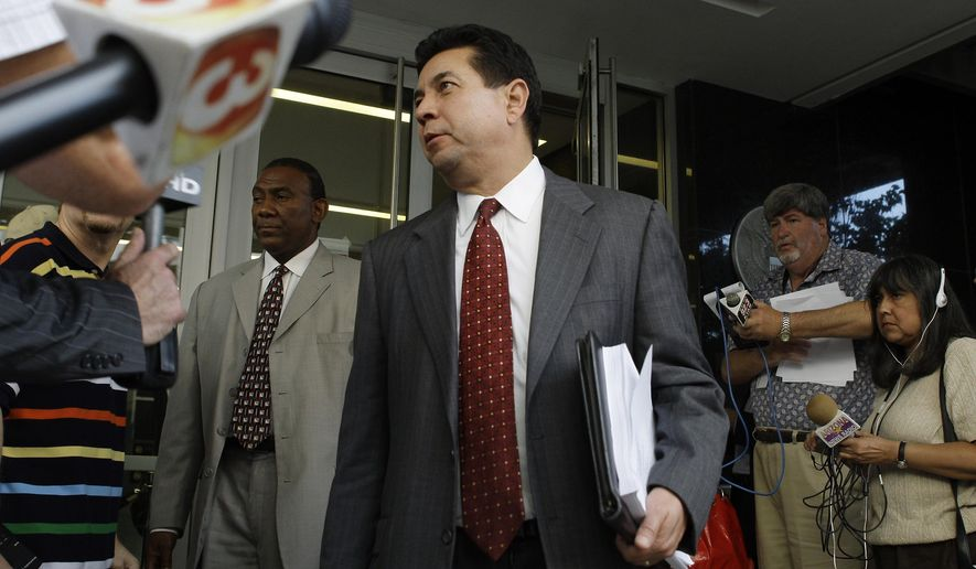 "FILE - In this May 19, 2009, file photo, Gary Husk, spokesman for the city of Glendale, Ariz., departs U.S. Bankruptcy Court after a hearing on the Phoenix Coyotes hockey team bankruptcy in Phoenix. Husk, ex-Phoenix lobbyist whose former clients included the Fiesta Bowl. A lawyer with a criminal record and who figured in a scandal involving the Fiesta Bowl has been selected to serve as a special prosecutor in two death-penalty homicide cases in Pinal County. Originally charged with multiple felonies that were dismissed in a plea deal, Gary Husk in 2014 pleaded guilty to a misdemeanor conspiracy charge in a case that centered on illegal campaign contributions. An attorney discipline panel later said his conduct reflected adversely on his ""honesty, trustworthiness or fitness as a lawyer."" (AP Photo/Ross D. Franklin, File)"