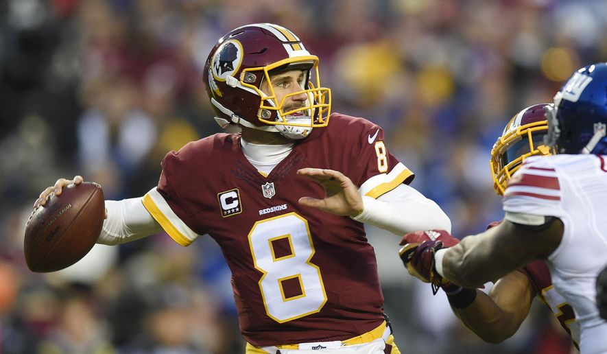 In this Jan. 1, 2017, file photo, Washington Redskins quarterback Kirk Cousins (8) passes during the first half of an NFL football game against the New York Giants in Landover, Md. In a move that seemed the most likely at this point in the odd dance between Kirk Cousins and the Washington Redskins, the team placed the exclusive franchise tag on the starting quarterback on Tuesday. (AP Photo/Nick Wass, File)