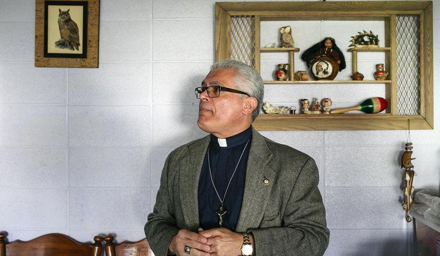 In this Friday, Feb. 24, 2017 photo, Father Antonio Illas looks over a room with a Native-American theme in the annex building of the Saint Matthew-San Mateo Episcopal Church in Auburn, Wash. Illas is a founding member of the sanctuary movement and says that his church would make space available to undocumented residents if necessary. (Johnny Andrews/The Seattle Times via AP)