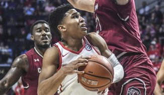 Mississippi guard Breein Tyree (4) drives against South Carolina Gamecocks forward Maik Kotsar (21) during an NCAA college basketball game Saturday, March 4, 2017, in Oxford, Miss. (Bruce Newman/Oxford Eagle via AP)