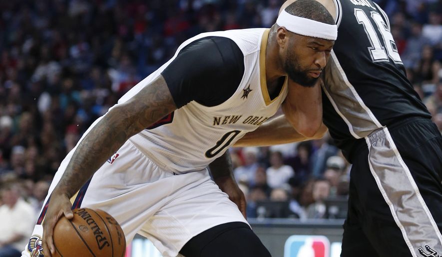 New Orleans Pelicans forward DeMarcus Cousins (0) drives to the basket against San Antonio Spurs center Pau Gasol (16) during the first half of an NBA basketball game in New Orleans, Friday, March 3, 2017. (AP Photo/Gerald Herbert)