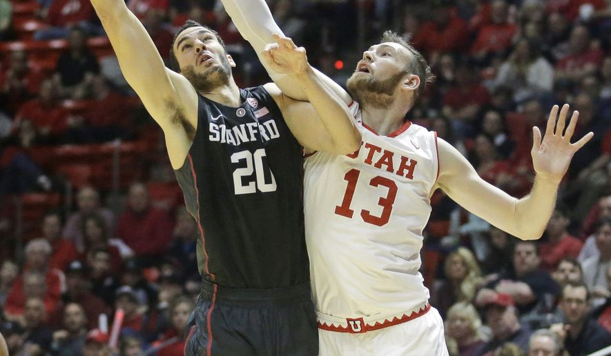 Stanford center Josh Sharma (20) goes to the basket as Utah forward David Collette (13) defends during the first half in an NCAA college basketball game Saturday, March 4, 2017, in Salt Lake City. (AP Photo/Rick Bowmer)