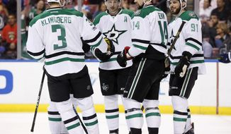 Dallas Stars left wing Jamie Benn (14) is congratulated by teammates after he scored during the first period of an NHL hockey game against the Florida Panthers, Saturday, March 4, 2017, in Sunrise, Fla. (AP Photo/Wilfredo Lee)