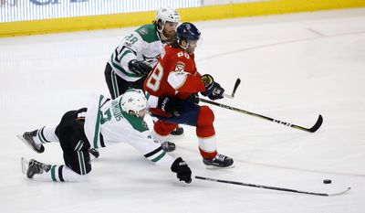 Dallas Stars defensemen Stephen Johns (28) and Dan Hamhuis (2) battle for the puck against Florida Panthers right wing Jaromir Jagr (68) during the second period of an NHL hockey game, Saturday, March 4, 2017, in Sunrise, Fla. (AP Photo/Wilfredo Lee)