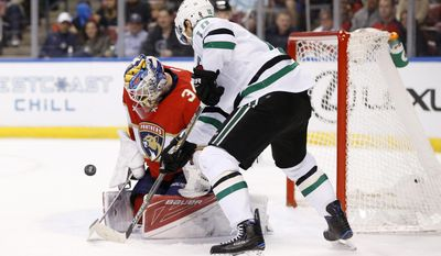 Florida Panthers goalie James Reimer makes a save as Dallas Stars left wing Patrick Sharp attempts a shot during the first period of an NHL hockey game, Saturday, March 4, 2017, in Sunrise, Fla. (AP Photo/Wilfredo Lee)