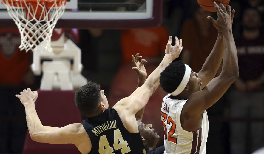 Virginia Tech's Zach LeDay (32) grabs an offensive rebound in front of Wake Forest's Konstantinos Mitoglou (44) during the first half of an NCAA college basketball game in Blacksburg ,Va.. Saturday, March 4, 2017. (Matt Gentry//The Roanoke Times via AP)