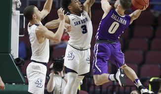 San Diego's Tyler Williams, left, and Olin Carter III guard Portland's Xavier Hallinan during the first half of a West Coast Conference tournament NCAA college basketball game Friday, March 3, 2017, in Las Vegas. (AP Photo/John Locher)