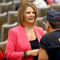 In this Tuesday, Aug. 2, 2016, file photo, former Arizona Republican state Sen. Kelli Ward, left, who was running against Sen. John McCain in the Arizona Republican primary, talked to a supporter of Republican presidential candidate Donald Trump at a campaign rally, in Phoenix. (AP Photo/Ross D. Franklin) ** FILE **