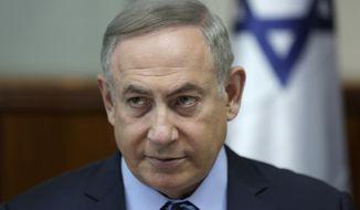 Israeli Prime Minister Benjamin Netanyahu attends the weekly Cabinet meeting at his office in Jerusalem, Sunday, March 5, 2017. (Abir Sultan, pool via AP)
