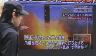 Japanese television showed news of North Korea's firing of four banned ballistic missiles, three of which that landed in Japan's exclusive economic zone. (Associated Press)