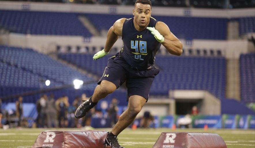 Stanford defensive end Solomon Thomas runs a drill at the NFL football scouting combine in Indianapolis, Sunday, March 5, 2017. (AP Photo/Michael Conroy)