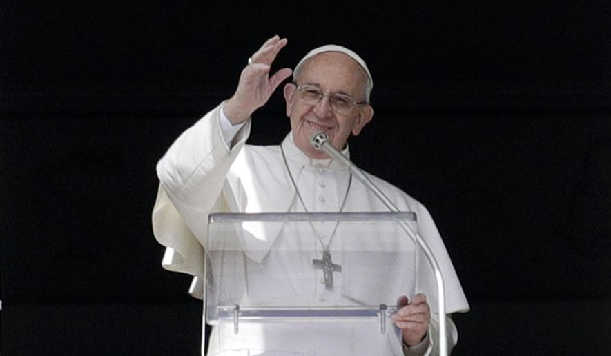 Pope Francis waves to faithful during the Angelus prayer delivered by Pope Francis in St. Peter's Square at the Vatican, Sunday, March 5, 2017. The pontiff has called on the faithful to consult the Bible with the same frequency as they might consult their smartphones for messages. (AP Photo/Gregorio Borgia) ** FILE **