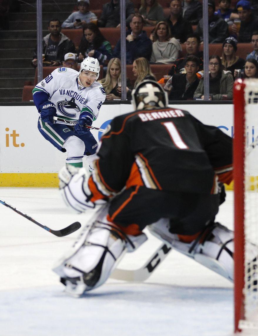 Vancouver Canucks' Brendan Gaunce, left, shoots toward Anaheim Ducks goalie Jonathan Bernier during the first period of an NHL hockey game, Sunday, March 5, 2017, in Anaheim, Calif. (AP Photo/Jae C. Hong)