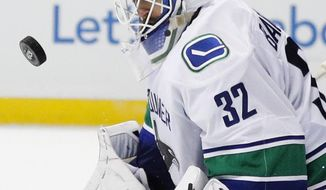 Vancouver Canucks goalie Richard Bachman deflects the puck during the second period of an NHL hockey game against the Anaheim Ducks, Sunday, March 5, 2017, in Anaheim, Calif. (AP Photo/Jae C. Hong)