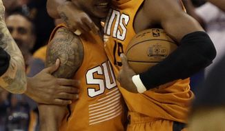 Phoenix Suns guard Tyler Ulis celebrates with Leandro Barbosa (19) after hitting the game winning shot against the Boston Celtics in the fourth quarter during an NBA basketball game, Sunday, March 5, 2017, in Phoenix. Phoenix defeated Boston 109-106. (AP Photo/Rick Scuteri)