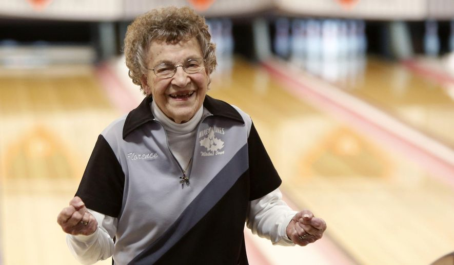 ADVANCE FOR USE SUNDAY, MARCH 5, 2017, AND THEREAFTER- In this Feb. 22, 2017, photo, Florence Ramsell celebrates after rolling a strike during league bowling at Maple Lanes in Waterloo, Iowa.  (Matthew Putney/The Courier via AP)