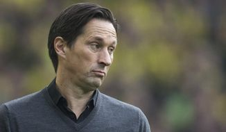 Coach Roger Schmidt from Leverkusen attends  the German Bundesliga soccer match between Borussia Dortmund and Bayer Leverkusen in the Signal Iduna Park in Dortmund, Germany,  Saturday, March 4, 2017.  (Bernd Thissen/dpa via AP)