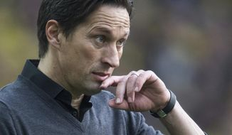 FILE - In this March 4, 2017 file photo Leverkusen Coach Roger Schmidt attends  the German Bundesliga soccer match between Borussia Dortmund and Bayer Leverkusen in the Signal Iduna Park in Dortmund, Germany. Bayer Leverkusen has sacked Roger Schmidt as coach as the side labors in its worst Bundesliga season for 14 years.  Leverkusen says in a statement that its shareholders' committee and supervisory board decided to let Schmidt go Sunday March 5, 2017  on the recommendation of club management. A successor will be named later. (Bernd Thissen/dpa via AP,file )
