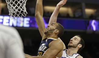 Utah Jazz center Rudy Gobert, left, goes to the basket against Sacramento Kings center Kosta Koufos during the first half of an NBA basketball game Sunday, March 5, 2017, in Sacramento, Calif.(AP Photo/Rich Pedroncelli)