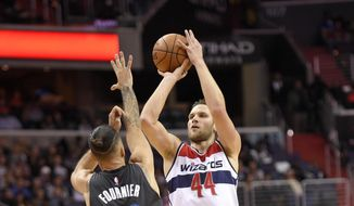 Washington Wizards guard Bojan Bogdanovic (44), of Bosnia and Herzegovina, shoots against Orlando Magic guard Evan Fournier (10), of France, during the second half of an NBA basketball game, Sunday, March 5, 2017, in Washington. The Wizards won 115-114. (AP Photo/Nick Wass)