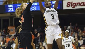 Chattanooga's forward Jasmine Joyner (3) shoots over Mercer's center Rachel Selph (34) during the first half of an NCAA college basketball game for the Southern Conference tournament championship in Asheville, N.C., Sunday, March 5, 2017. (AP Photo/Kathy Kmonicek)